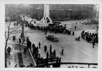 Hungarian Freedom Fighters attempt to remove the Communist star from the top of the Sovier WW2 memorial during the 1956 revolution. Photographed by the balcony of the U.S. Legation by the newly arrived American Consul, Christopher Squire.