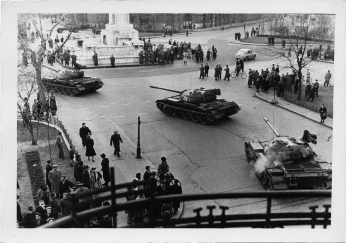 Soviet tanks rolling into Liberty Square during the 1956 revolution in Budapest. Photo taken from the balcony of the U.S. Legation by the new Consul, Christopher Squire.